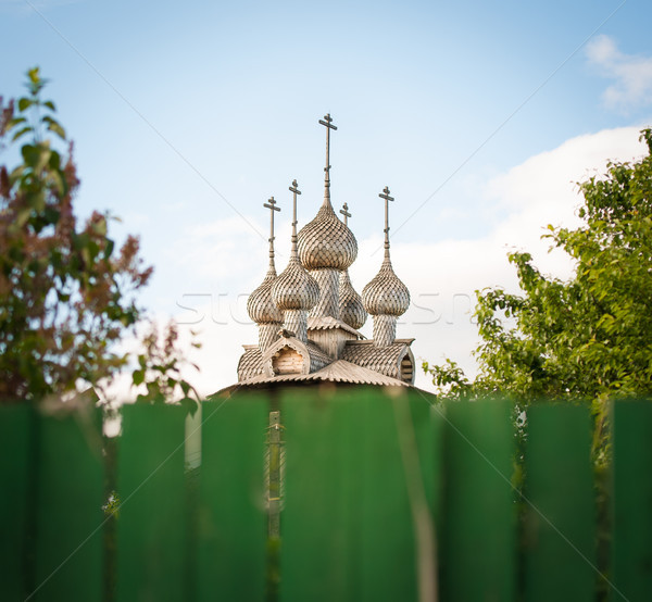 Old Russian wooden church. View over fence. Stock photo © kyolshin