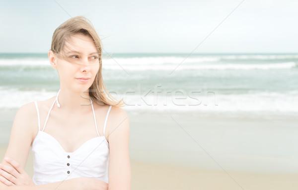 Pretty woman on beach looking somewhere. Stock photo © kyolshin