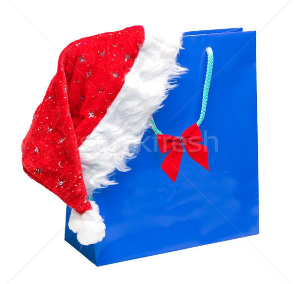 blue packet with santa hat Stock photo © kyolshin