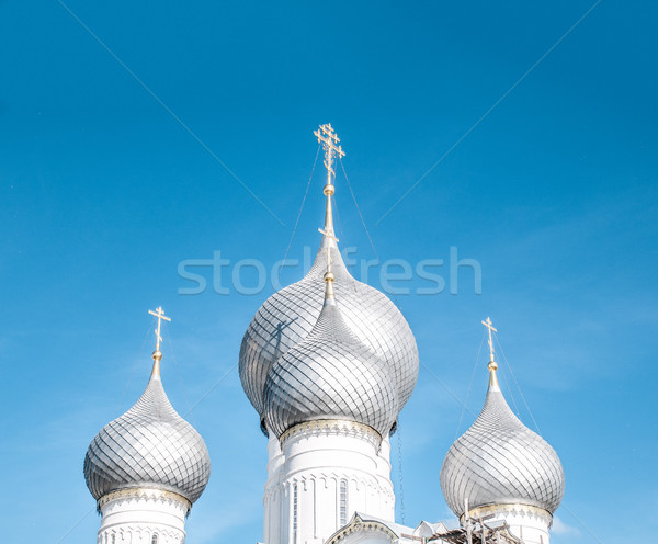 Domes of russian church against blue sky. Stock photo © kyolshin