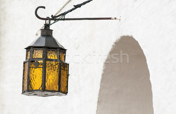 Vintage lantern hanging above arched entry. Stock photo © kyolshin