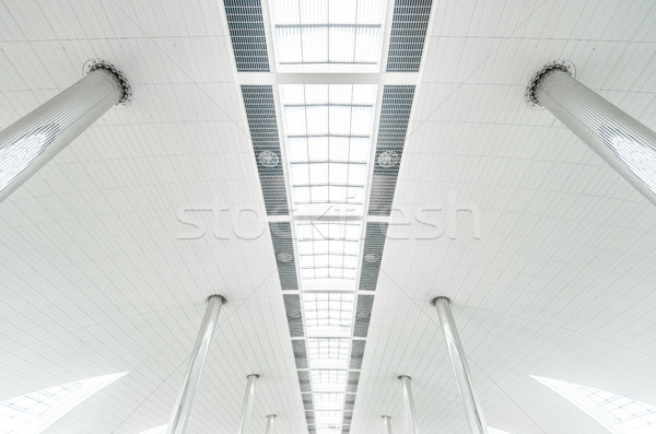 Metal columns and modern glass ceiling at airport. Stock photo © kyolshin