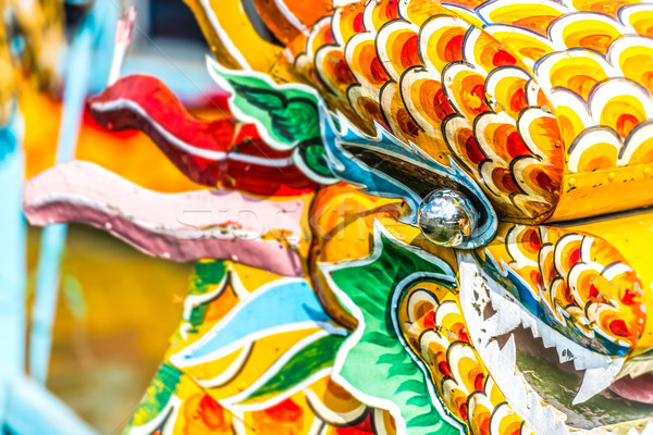 Multicolored face of vietnamese dragon. Stock photo © kyolshin