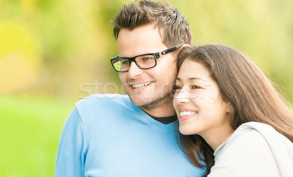Portrait of happy young man and woman in park. Stock photo © kyolshin