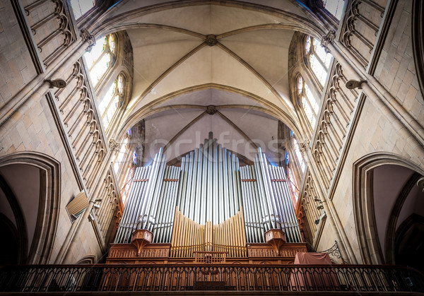 Great organ under arch in catholic church. Stock photo © kyolshin