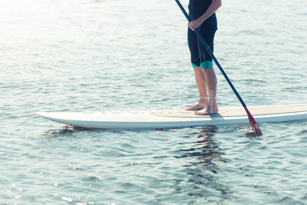 Man on paddleboard Stock photo © kyolshin