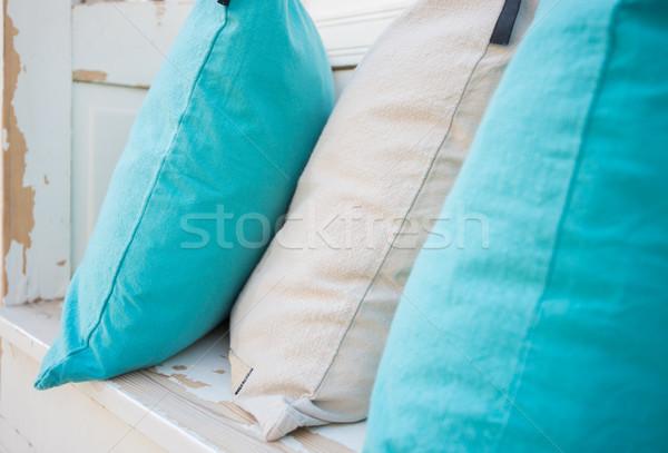 Colourful pillows on white wooden bench Stock photo © kyolshin