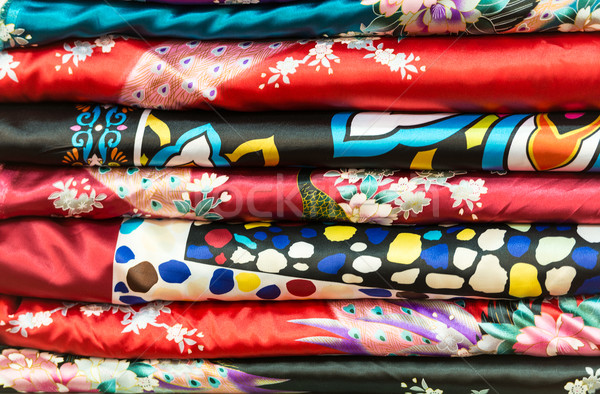 Pile of silk clothes with abstract asian design. Stock photo © kyolshin