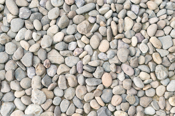 Pebble heap as abstract natural background. Stock photo © kyolshin