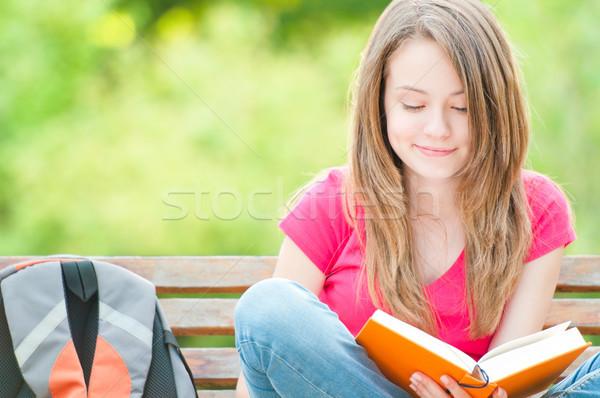 Boldog diák lány ül pad könyv Stock fotó © kyolshin