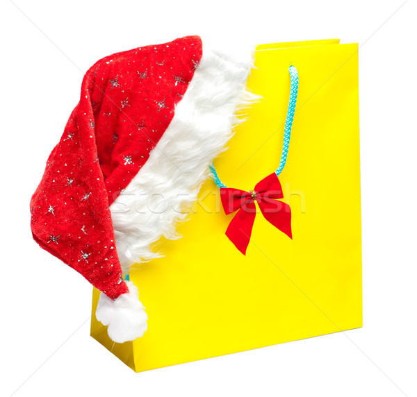 yellow packet with santa hat Stock photo © kyolshin