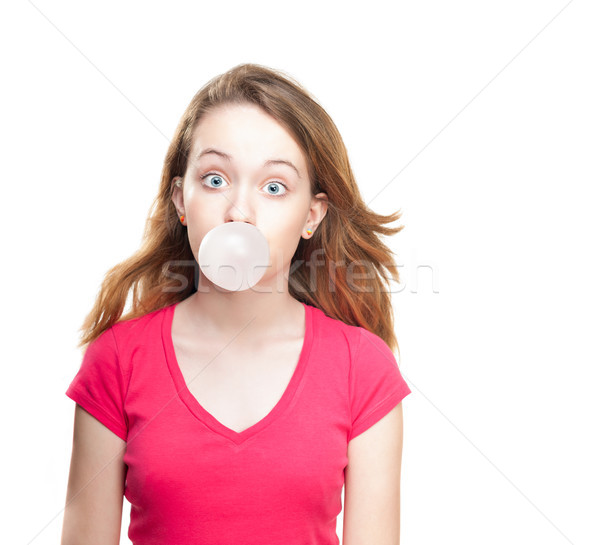 Stock photo: Girl blowing bubble from chewing gum
