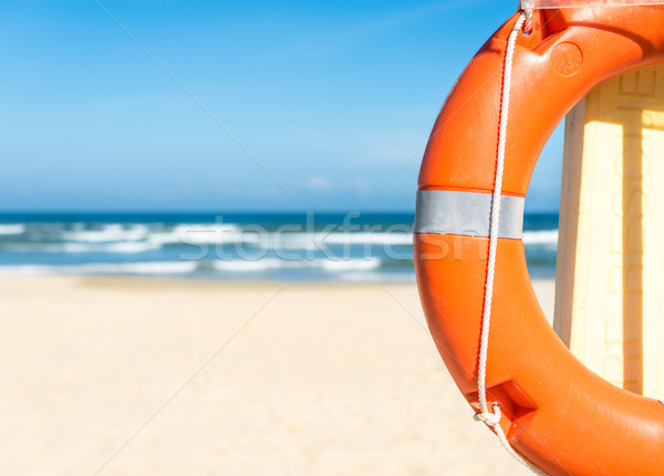 Seascape with lifebuoy, blue sky and sandy beach. Stock photo © kyolshin