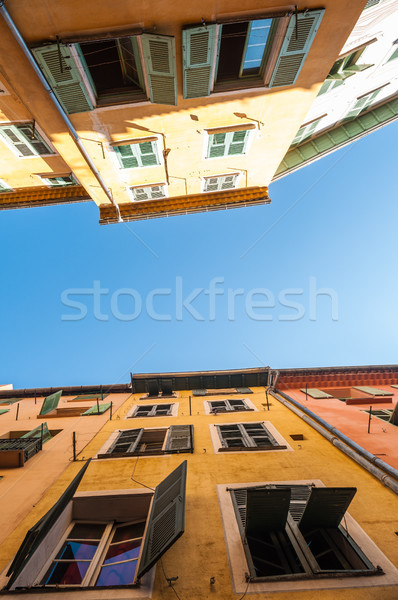 Two traditional houses in Nice city, France. Stock photo © kyolshin