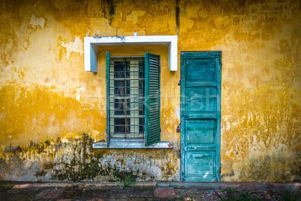 Old and worn house on street in Vietnam. Stock photo © kyolshin