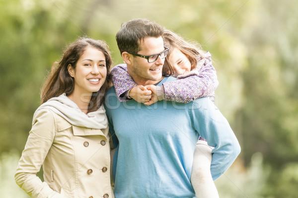 Happy family of three having fun outdoor. Stock photo © kyolshin