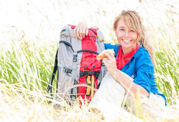 Young tourist woman having lunch outdoors. Stock photo © kyolshin
