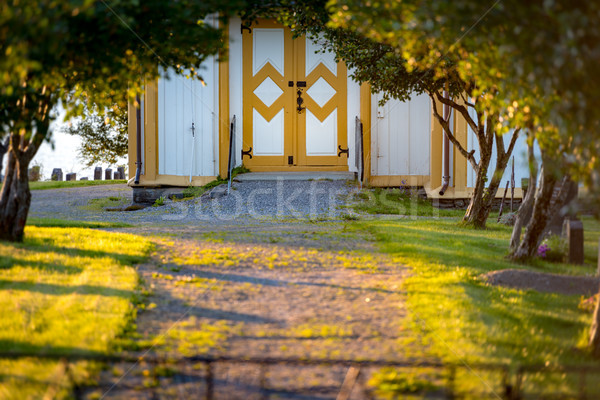 Path from green forest to entrance of building. Stock photo © kyolshin