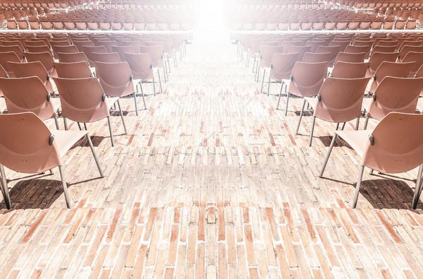 Rows of plastic chairs. Stock photo © kyolshin