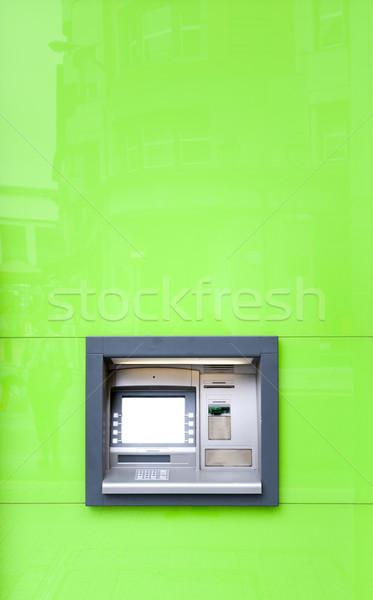 Caixa eletrônico máquina verde parede brilhante sol Foto stock © kyolshin