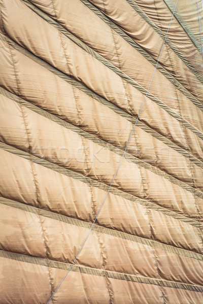 Light brown sail of vietnamese boat close up. Stock photo © kyolshin
