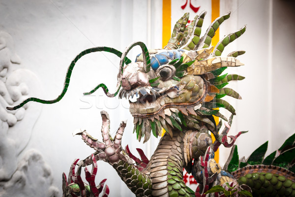 Dragon statue on white background, Vietnam, Asia. Stock photo © kyolshin