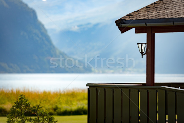 Ház tó Norvégia Európa hegyek kék ég Stock fotó © kyolshin