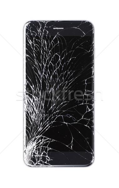 Damaged modern phone on white background Stock photo © kyolshin