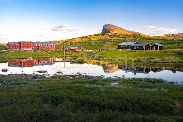 Norvegia paese case montagna blu Foto d'archivio © kyolshin