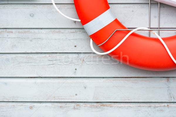 Orange lifebuoy on white wall in port Stock photo © kyolshin