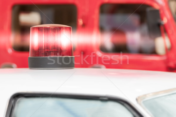 Flashing Red Siren Light on Roof of Vehicle Stock photo © kyolshin