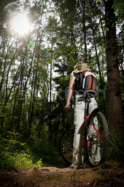 young woman with bicycle in forest Stock photo © kyolshin