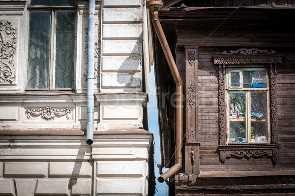 Two houses in Russia: old wooden and brick. Stock photo © kyolshin