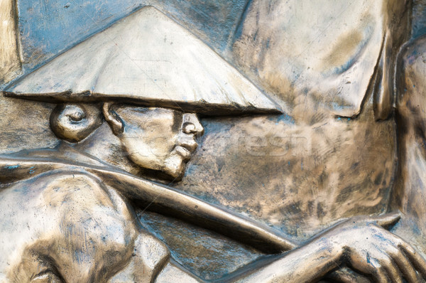 Part of monument with man in hat in Vietnam, Asia. Stock photo © kyolshin