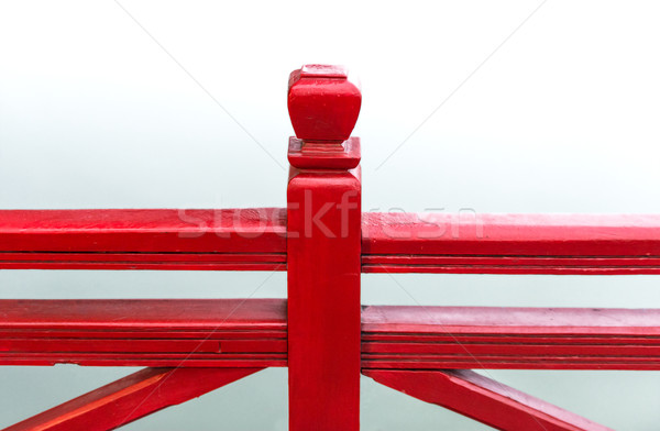 Detail of wooden red bridge with water background. Stock photo © kyolshin