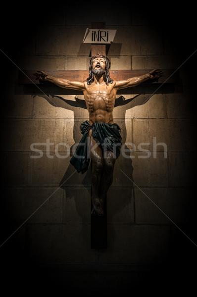 Crucifix in church on the stone wall. Stock photo © kyolshin