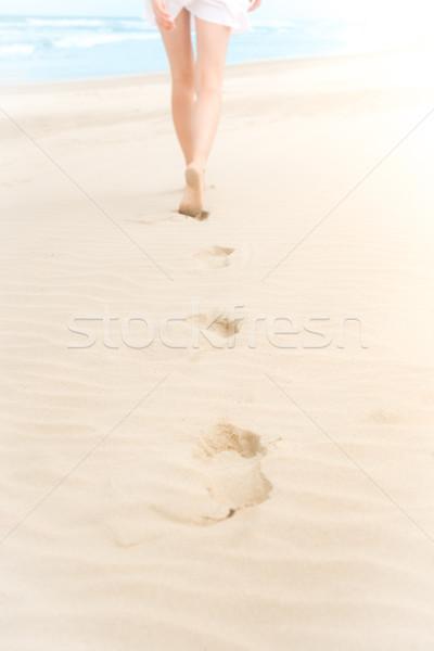 Slim girl in white swimsuit walking to ocean. Stock photo © kyolshin