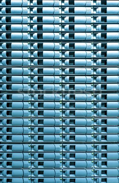 Seamless blue background of server disk storage. Stock photo © kyolshin