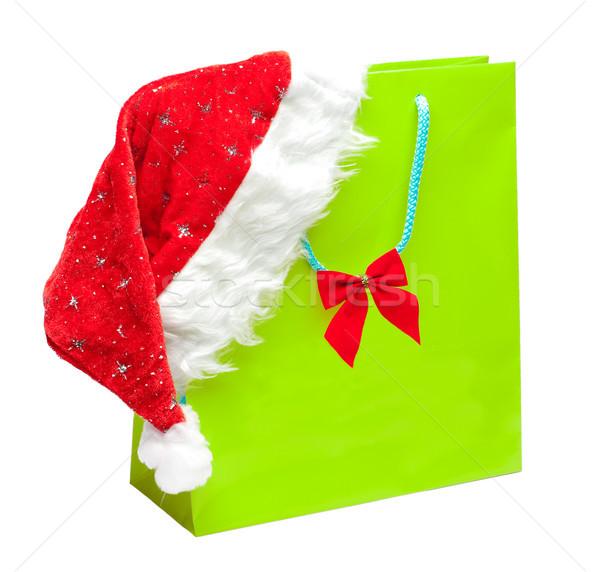 green packet with santa hat Stock photo © kyolshin