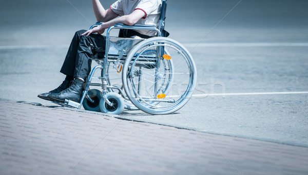 Young man in wheelchair on the road alone. Stock photo © kyolshin