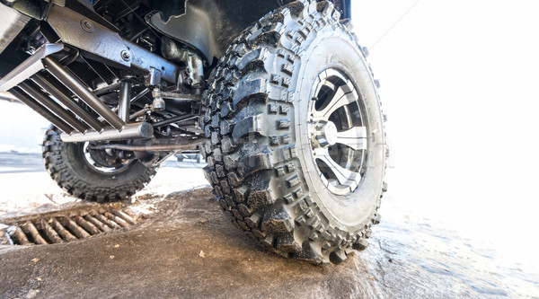 Car tire with offroad pattern close-up on road. Stock photo © kyolshin
