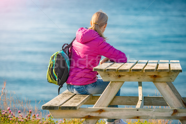 Girl on bench table at shore in Norway, Europe Stock photo © kyolshin