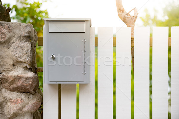 Post box on wooden fence. Sweden, Europe Stock photo © kyolshin