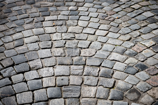 Old cobblestone road in city of Europe Stock photo © kyolshin