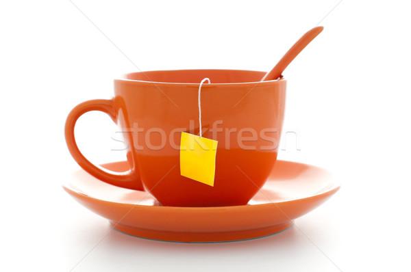 orange cup with tea bag Stock photo © kyolshin