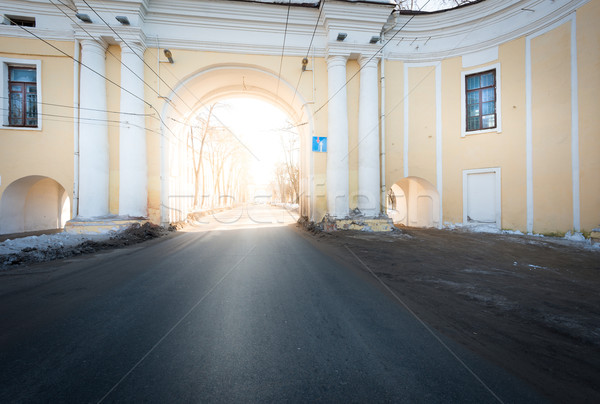 Arch house and asphalt road passing through it. Stock photo © kyolshin