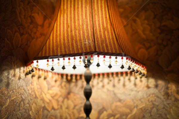 Classic lamp with dim light near wall. Stock photo © kyolshin
