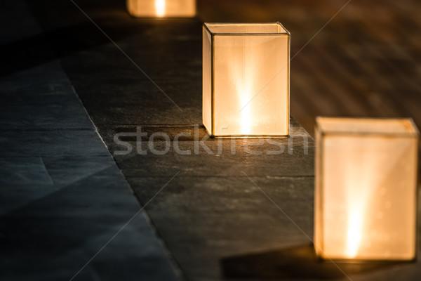 Square lanterns with dim light on street. Stock photo © kyolshin