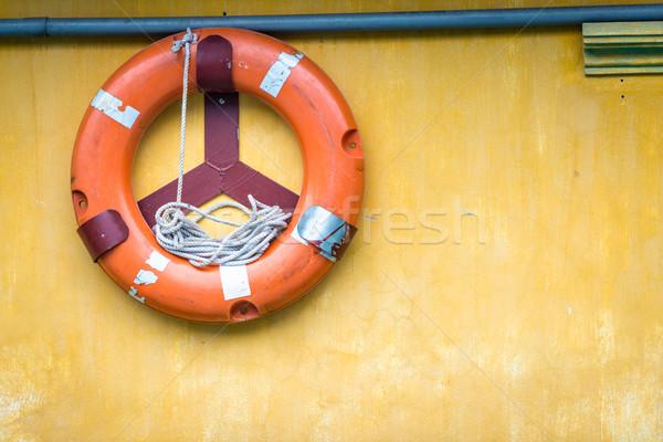 Turuncu eski halat bağlı duvar sarı Stok fotoğraf © kyolshin
