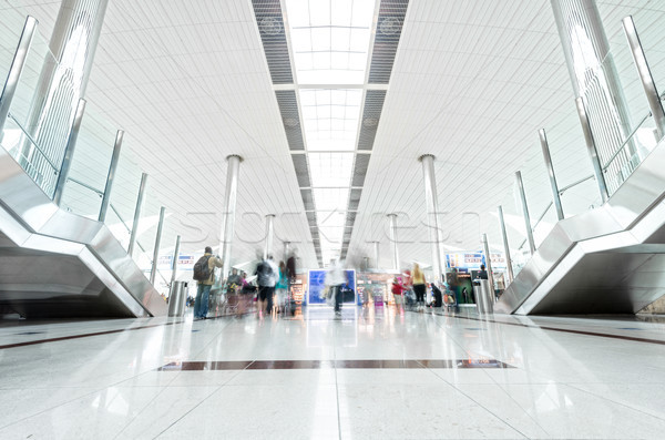 Modern airport hall with passengers in Dubai. Stock photo © kyolshin